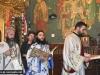 Priests read the Gospel