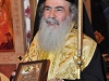 The Patriarch offers an icon of the Holy Sepulchre to the Greek Community