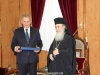 Mr Photiou offers the Patriarch a gift