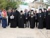 H.B., the Entourage and hegumen Nicodemus walk to the church