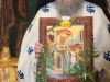 Hieromonk Ignation carrying the icon of the Entrance into the Temple