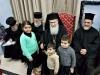 His Beatitude offers presents to St Demetrios School pupils