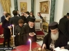 His Beatitude offers a piece of cake to the Metropolitan of Helenoupolis