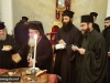 His Beatitude offers a piece of cake to Geronda Secretary-General