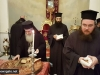 His Beatitude offers a piece of cake to Archimandrite Ieronymos