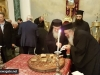His Beatitude offers a piece of cake to Archimandrite Aristovoulos