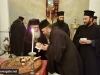His Beatitude offers a piece of cake to Archimandrite Epiphanios