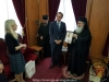 His Beatitude offering an icon of Theotokos of Jerusalem
