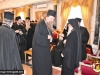His Beatitude offering the Priests crosses as blessings