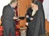 His Beatitude offering Mr. Katrougalos an icon of the Theotokos