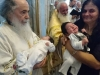 His Beatitude praying for forty-days-old infants
