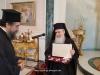 The Most Rev. Metropolitan of Serres, offering His Beatitude a set of egolpia
