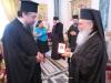H.H.B. offers His Eminence a Kalfa Komnenos Cross