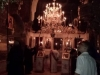 Monks of the Monastery lighting the candles of the chandeliers