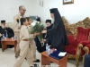 Young Scouts offer His Beatitude bunches of flowers