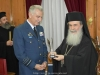 Mr. Christodoulou offering His Beatitude the emblem of the Hellenic Air Force