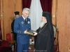 His Beatitude offering Mr. Christodoulou a tome of the History of Jerusalem