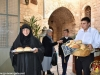 Gerondissa Seraphima distributing the small loaves of bread at the gate