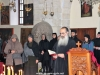 Archimandrite Aristovoulos reading the incident of the feast from the book of Acts