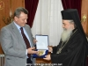 Mr. Leontaris offers His Beatitude the emblem of the National Guard of Cyprus