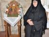 Nun Stylliani at the iconostasion