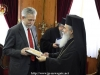 His Beatitude offers the Minister an icon of the Theotokos