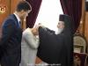 His Beatitude offers Mrs. Tymoshenko a pectoral cross