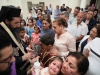 The Archbishop of Qatar and the congregation at the Holy Unction