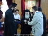The student's parents receive souvenirs of their visit to the Holy City
