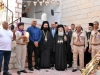 His Beatitude's welcome by Arch. Niphon, Scouts, and Community members