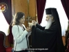 His Beatitude offers a cross to Mrs. Yiannaki