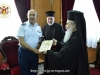 His Beatitude offers Mr. Yiannakis an icon of the Theotokos