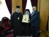 The Most Reverend Metropolitan Isaiah of Tamasos offers His Beatitude an icon of St. Andrew