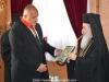 His Beatitude offers Mr. Borissov an icon of the Theotokos